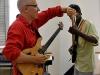 photo-by-staff-sgt-renae-saylock-usaf_joe-preps-strings-of-guitarist_sept-21-workshop